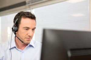 Man using a headset at a computer